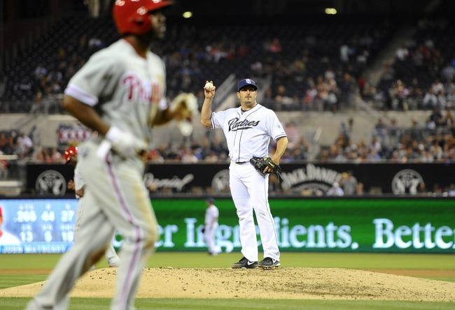 June 25, 2013; San Diego, CA, USA; San Diego Padres starting pitcher Jason Marquis (21) reacts after a bases-loaded walk to score Philadelphia Phillies shortstop Jimmy Rollins (11) during the fifth inning at Petco Park. Mandatory Credit: Christopher Hanewinckel-USA TODAY Sports
