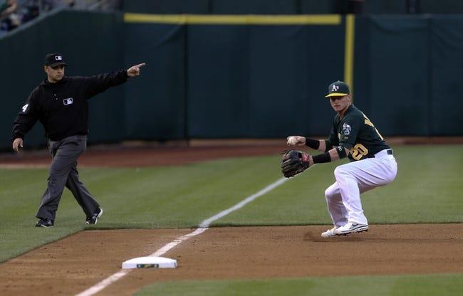 Jun 25, 2013; Oakland, CA, USA; Oakland Athletics third baseman Josh Donaldson (20) controls the ball against the Cincinnati Reds during the fourth inning at O.co Coliseum. Mandatory Credit: Kelley L Cox-USA TODAY Sports
