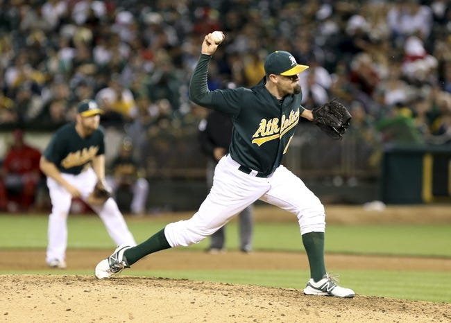 Jun 25, 2013; Oakland, CA, USA; Oakland Athletics relief pitcher Pat Neshek (47) pitches the ball against the Cincinnati Reds during the sixth inning at O.co Coliseum. The Oakland Athletics defeated the Cincinnati Reds 7-3. Mandatory Credit: Kelley L Cox-USA TODAY Sports