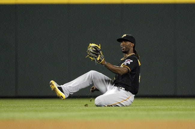 Jun 25, 2013; Seattle, WA, USA; Pittsburgh Pirates center fielder Andrew McCutchen (22) makes a catch against the Seattle Mariners during the eighth inning at Safeco Field. Mandatory Credit: Joe Nicholson-USA TODAY Sports