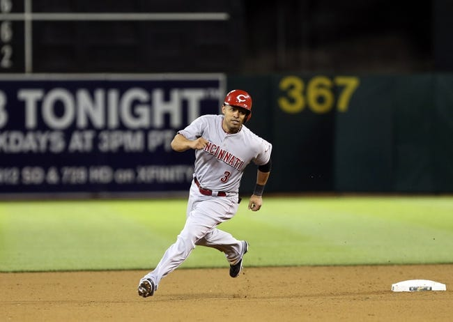 Jun 25, 2013; Oakland, CA, USA; Cincinnati Reds shortstop Cesar Izturis (3) rounds second base against the Oakland Athletics during the eighth inning at O.co Coliseum. The Oakland Athletics defeated the Cincinnati Reds 7-3. Mandatory Credit: Kelley L Cox-USA TODAY Sports