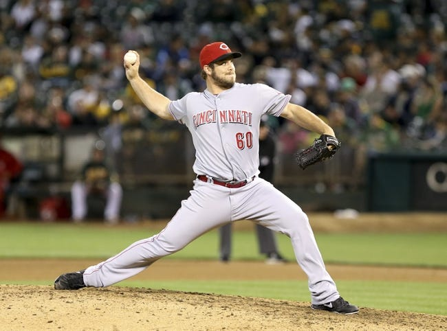 Jun 25, 2013; Oakland, CA, USA; Cincinnati Reds relief pitcher J.J. Hoover (60) pitches the ball against the Oakland Athletics during the eighth inning at O.co Coliseum. The Oakland Athletics defeated the Cincinnati Reds 7-3. Mandatory Credit: Kelley L Cox-USA TODAY Sports