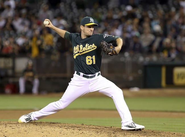 Jun 25, 2013; Oakland, CA, USA; Oakland Athletics relief pitcher Dan Otero (61) pitches the ball against the Cincinnati Reds during the ninth inning at O.co Coliseum. The Oakland Athletics defeated the Cincinnati Reds 7-3. Mandatory Credit: Kelley L Cox-USA TODAY Sports
