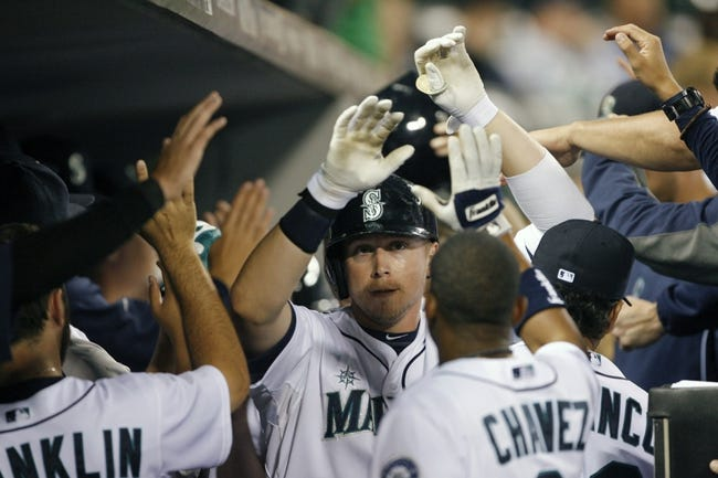 Jun 25, 2013; Seattle, WA, USA; Seattle Mariners first baseman Justin Smoak (17) is greeted in the dugout after hitting a two-run home run against the Pittsburgh Pirates during the ninth inning at Safeco Field. Mandatory Credit: Joe Nicholson-USA TODAY Sports