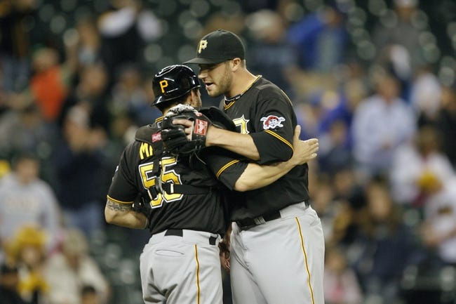 Jun 25, 2013; Seattle, WA, USA; Pittsburgh Pirates pitcher Duke Welker (61) embraces catcher Russell Martin (55) after the final out against the Seattle Mariners at Safeco Field. Pittsburgh defeated Seattle, 9-4. Mandatory Credit: Joe Nicholson-USA TODAY Sports