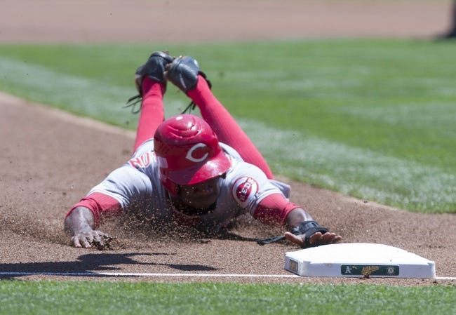 Jun 26, 2013; Oakland, CA, USA; Cincinnati Reds left fielder Derrick Robinson (15) steals third base during the first inning of the game against the Oakland Athletics at O.Co Coliseum. Mandatory Credit: Ed Szczepanski-USA TODAY Sports