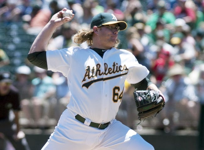 Jun 26, 2013; Oakland, CA, USA; Oakland Athletics starting pitcher A.J. Griffin (64) pitches against the Cincinnati Reds during the first inning at O.Co Coliseum. Mandatory Credit: Ed Szczepanski-USA TODAY Sports