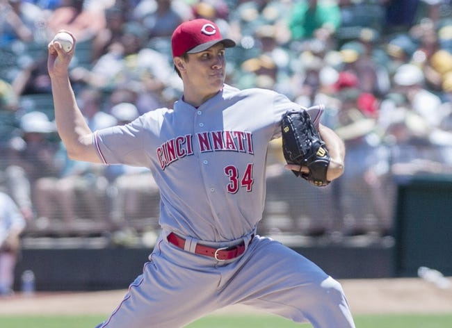 Jun 26, 2013; Oakland, CA, USA; Cincinnati Reds starting pitcher Homer Bailey (34) pitches against the Oakland Athletics during the first inning at O.Co Coliseum. Mandatory Credit: Ed Szczepanski-USA TODAY Sports