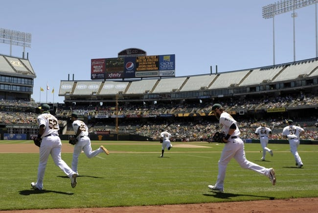 Jun 26, 2013; Oakland, CA, USA; The Oakland Athletics take the field before the game against the Cincinnati Reds at O.Co Coliseum. Mandatory Credit: Ed Szczepanski-USA TODAY Sports