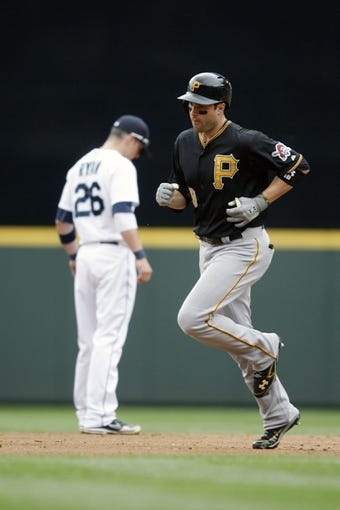 Jun 26, 2013; Seattle, WA, USA; Pittsburgh Pirates second baseman Neil Walker (18) rounds the bases after hitting a two-run home run against the Seattle Mariners during the fourth inning at Safeco Field. Pittsburgh defeated Seattle, 4-2. Mandatory Credit: Joe Nicholson-USA TODAY Sports