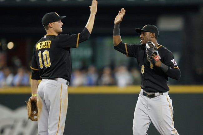 Jun 26, 2013; Seattle, WA, USA; Pittsburgh Pirates shortstop Jordy Mercer (10) celebrates the final out against the Seattle Mariners with left fielder Starling Marte (6) at Safeco Field. Pittsburgh defeated Seattle, 4-2. Mandatory Credit: Joe Nicholson-USA TODAY Sports