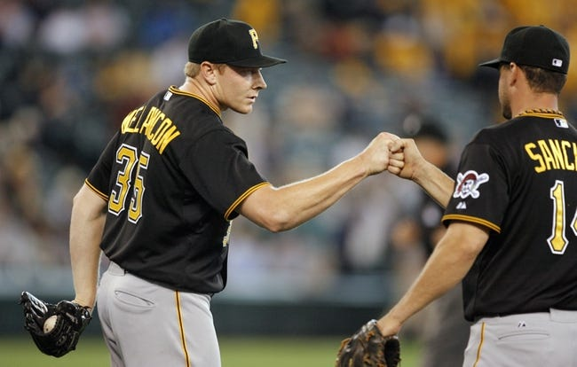 Jun 26, 2013; Seattle, WA, USA; Pittsburgh Pirates pitcher Mark Melancon (35) celebrates the final out against the Seattle Mariners with first baseman Gaby Sanchez (18) at Safeco Field. Pittsburgh defeated Seattle, 4-2. Mandatory Credit: Joe Nicholson-USA TODAY Sports