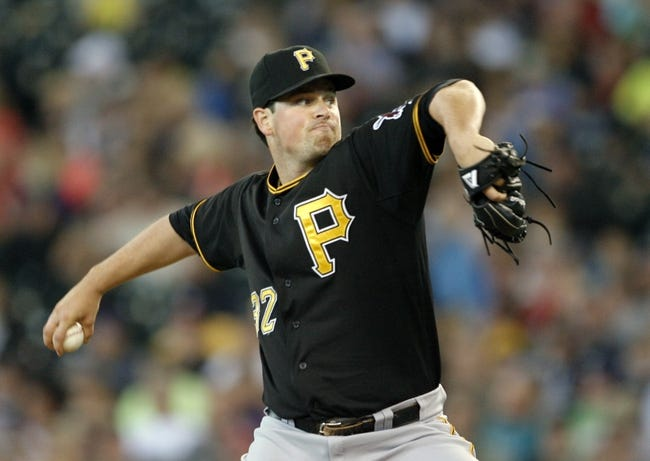 Jun 26, 2013; Seattle, WA, USA; Pittsburgh Pirates pitcher Vin Mazzaro (32) throws against the Seattle Mariners during the seventh inning at Safeco Field. Pittsburgh defeated Seattle, 4-2. Mandatory Credit: Joe Nicholson-USA TODAY Sports
