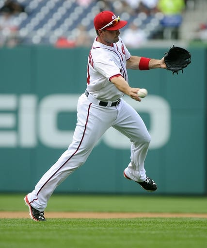 Jun 27, 2013; Washington, DC, USA; Washington Nationals third baseman Ryan Zimmerman (11) throws out Arizona Diamondbacks first baseman Paul Goldschmidt (not shown) at first base during the first inning at Nationals Park.  Mandatory Credit: Brad Mills-USA TODAY Sports