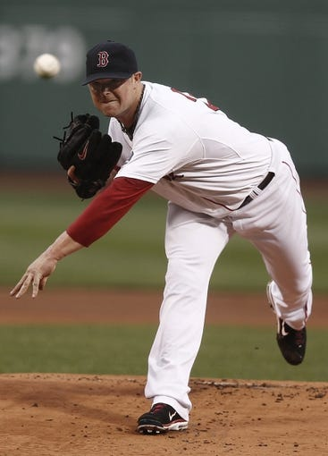 Jun 27, 2013; Boston, MA, USA;  Boston Red Sox starting pitcher Jon Lester delivers against the Toronto Blue Jays during the first inning at Fenway Park. Mandatory Credit: Winslow Townson-USA TODAY Sports