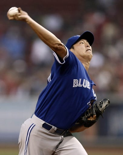 Jun 27, 2013; Boston, MA, USA;  Toronto Blue Jays starting pitcher Chien-Ming Wang delivers against the Boston Red Sox during the first inning at Fenway Park. Mandatory Credit: Winslow Townson-USA TODAY Sports