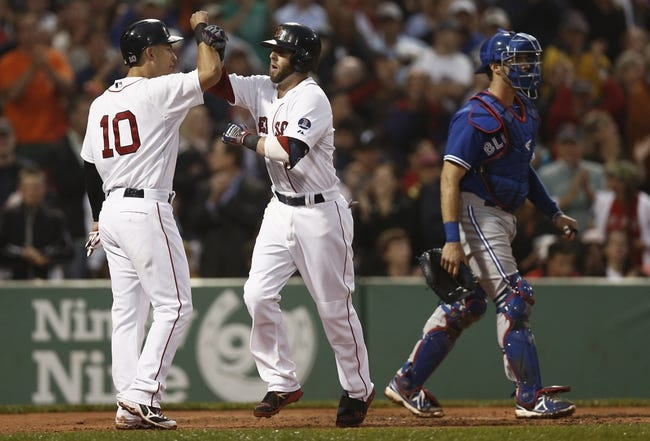 Jun 27, 2013; Boston, MA, USA;  Boston Red Sox infielder Dustin Pedroia is greeted by teammate Jose Iglesias (10) after his two-run home run as Toronto Blue Jays catcher J.P. Arencibia walks away during the second inning at Fenway Park. Mandatory Credit: Winslow Townson-USA TODAY Sports