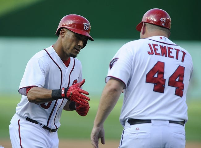 Jun 27, 2013; Washington, DC, USA; Washington Nationals shortstop Ian Desmond (20) is congratulated by third base coach Trent Jewett after hitting a two run homer during the game against the Arizona Diamondbacks during the fourth inning at Nationals Park.  Mandatory Credit: Brad Mills-USA TODAY Sports