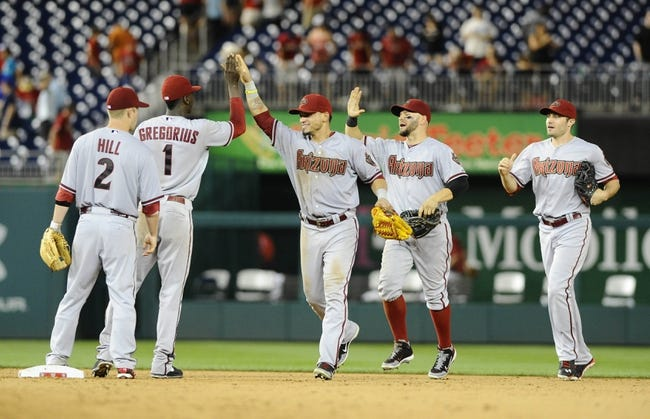 Jun 27, 2013; Washington, DC, USA; Arizona Diamondbacks players celebrate after recording the final out after the eleventh inning against the Washington Nationals at Nationals Park.  Mandatory Credit: Brad Mills-USA TODAY Sports