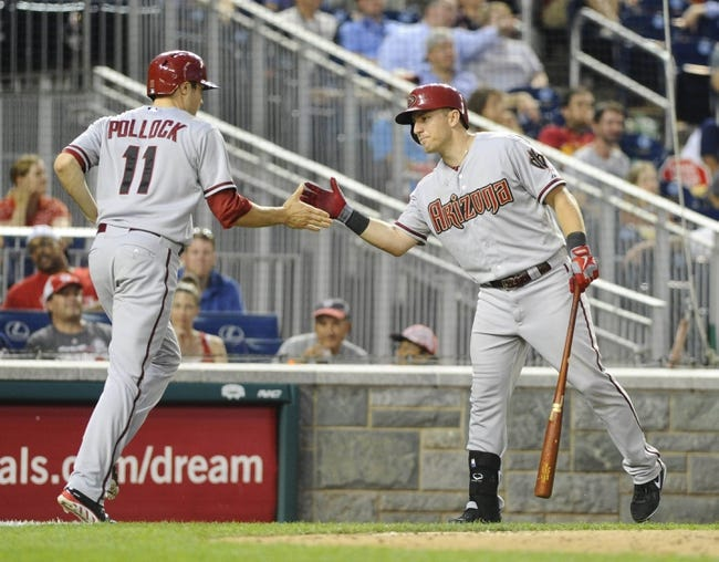 Jun 27, 2013; Washington, DC, USA; Arizona Diamondbacks center fielder A.J. Pollock (11) is congratulated by third baseman Cliff Pennington (4) after scoring the winning run during the eleventh inning against the Washington Nationals at Nationals Park.  Mandatory Credit: Brad Mills-USA TODAY Sports