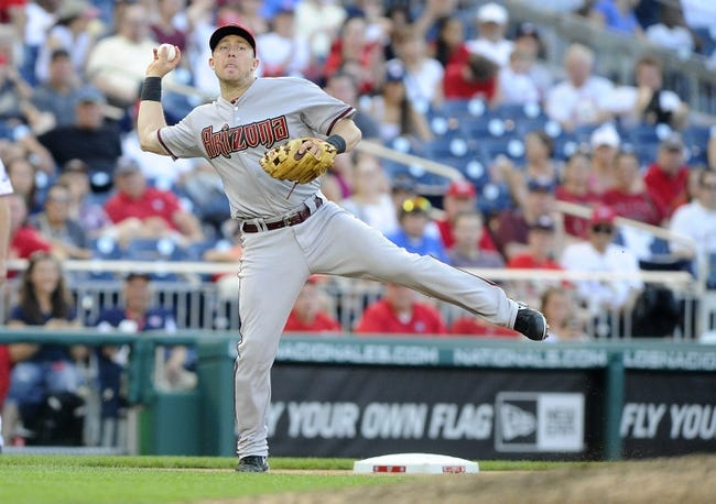 Jun 27, 2013; Washington, DC, USA; Arizona Diamondbacks third baseman Cliff Pennington (4) throws out Washington Nationals second baseman Anthony Rendon (not shown) during the eighth inning at Nationals Park.  Mandatory Credit: Brad Mills-USA TODAY Sports