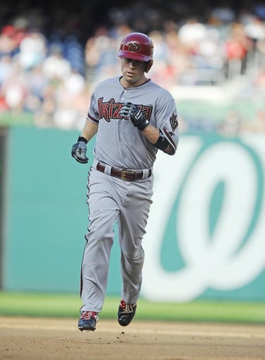 Jun 27, 2013; Washington, DC, USA; Arizona Diamondbacks second baseman Aaron Hill (2) rounds the bases after hitting a two run homer during the sixth inning against the Washington Nationals at Nationals Park.  Mandatory Credit: Brad Mills-USA TODAY Sports