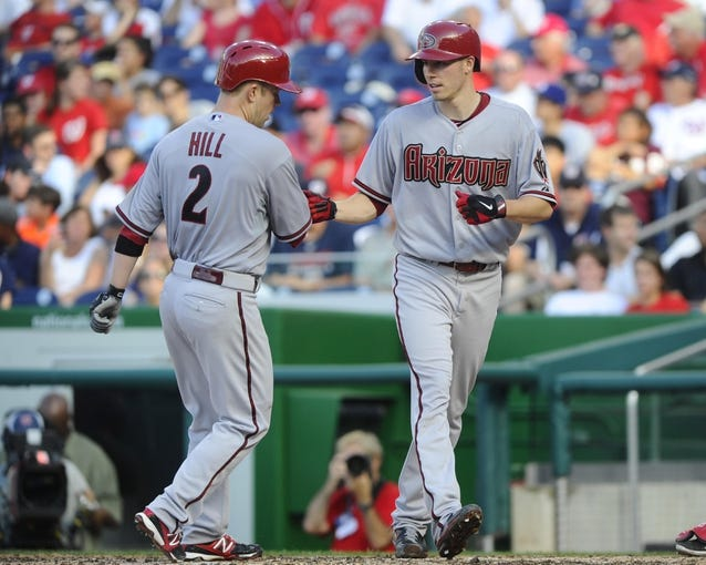 Jun 27, 2013; Washington, DC, USA; Arizona Diamondbacks second baseman Aaron Hill (2) is congratulated by starting pitcher Patrick Corbin (46) at home plate after hitting a two run homer during the sixth inning against the Washington Nationals at Nationals Park.  Mandatory Credit: Brad Mills-USA TODAY Sports