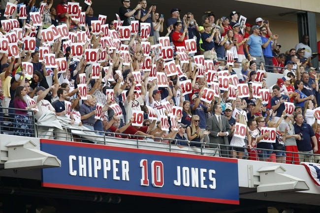 Jun 28, 2013; Atlanta, GA, USA; Fans hold up the number ten in honor of former Atlanta Braves third baseman Chipper Jones (not pictured) as his number is retired before a game against the Arizona Diamondbacks at Turner Field. Mandatory Credit: Brett Davis-USA TODAY Sports