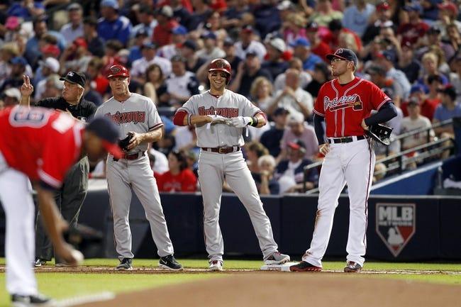 Jun 28, 2013; Atlanta, GA, USA; Arizona Diamondbacks third baseman Martin Prado (14) reacts after a single against the Atlanta Braves in the fourth inning at Turner Field. Mandatory Credit: Brett Davis-USA TODAY Sports