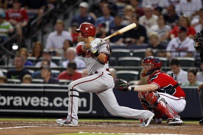 Jun 28, 2013; Atlanta, GA, USA; Arizona Diamondbacks third baseman Martin Prado (14) hits a single against the Atlanta Braves in the fourth inning at Turner Field. Mandatory Credit: Brett Davis-USA TODAY Sports