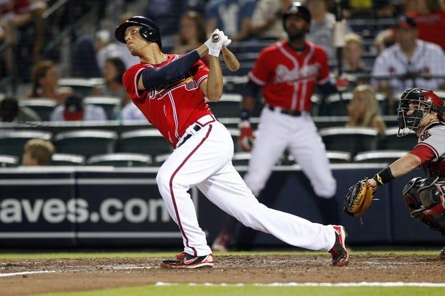 Jun 28, 2013; Atlanta, GA, USA; Atlanta Braves shortstop Andrelton Simmons (19) hits a home run against the Arizona Diamondbacks in the fifth inning at Turner Field. Mandatory Credit: Brett Davis-USA TODAY Sports