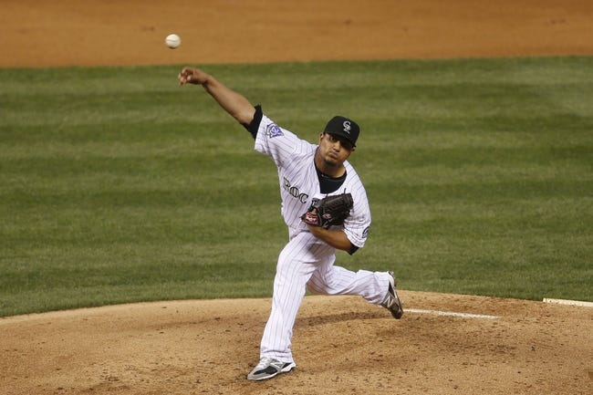 Jun 28, 2013; Denver, CO, USA; Colorado Rockies pitcher Jhoulys Chacin (45) delivers a pitch during the second inning against the San Francisco Giants at Coors Field. Mandatory Credit: Chris Humphreys-USA TODAY Sports