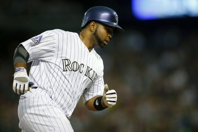 Jun 28, 2013; Denver, CO, USA; Colorado Rockies catcher Wilin Rosario (20) runs the bases after hitting a home run during the third inning against the San Francisco Giants at Coors Field. Mandatory Credit: Chris Humphreys-USA TODAY Sports