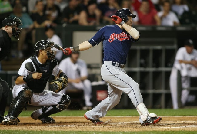 Jun 28, 2013; Chicago, IL, USA; Cleveland Indians second baseman Jason Kipnis hits a RBI double against the Chicago White Sox during the first inning in the second game of a baseball doubleheader at US Cellular Field. Mandatory Credit: Jerry Lai-USA TODAY Sports