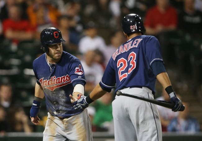 Jun 28, 2013; Chicago, IL, USA; Cleveland Indians second baseman Jason Kipnis (left) is congratulated by left fielder Michael Brantley (23) after scoring on a wild pitch against the Chicago White Sox during the first inning in the second game of a baseball doubleheader at US Cellular Field. Mandatory Credit: Jerry Lai-USA TODAY Sports