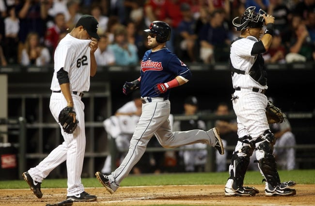 Jun 28, 2013; Chicago, IL, USA; Cleveland Indians first baseman Nick Swisher (middle) scores a run as Chicago White Sox starting pitcher Jose Quintana (62) and catcher Hector Gimenez (38) react during the first inning in the second game of a baseball doubleheader at US Cellular Field. Mandatory Credit: Jerry Lai-USA TODAY Sports