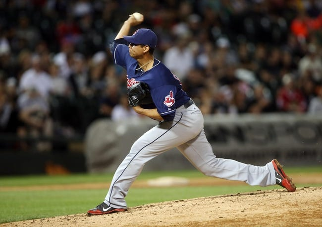 Jun 28, 2013; Chicago, IL, USA; Cleveland Indians starting pitcher Carlos Carrasco throws a pitch against the Chicago White Sox during the first inning in the second game of a baseball doubleheader at US Cellular Field. Mandatory Credit: Jerry Lai-USA TODAY Sports
