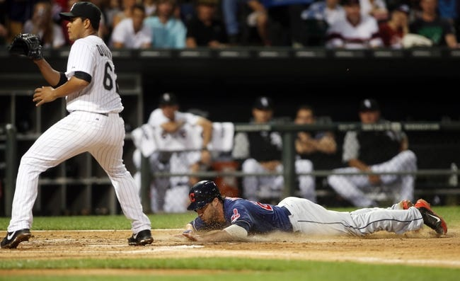 Jun 28, 2013; Chicago, IL, USA; Cleveland Indians second baseman Jason Kipnis (right) scores on a wild pitch past Chicago White Sox starting pitcher Jose Quintana (62) during the first inning in the second game of a baseball doubleheader at US Cellular Field. Mandatory Credit: Jerry Lai-USA TODAY Sports