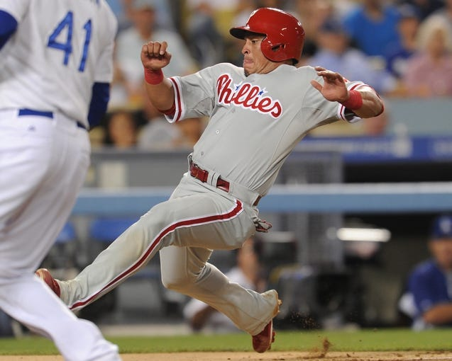 Jun 28, 2013; Los Angeles, CA, USA;  Philadelphia Phillies catcher Carlos Ruiz (51) is out at the plate in the fifth inning of the game against the Los Angeles Dodgers at Dodger Stadium. Mandatory Credit: Jayne Kamin-Oncea-USA TODAY Sports
