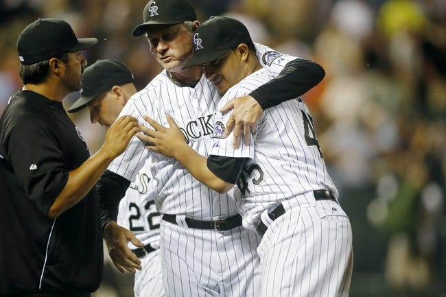 Jun 28, 2013; Denver, CO, USA; Colorado Rockies pitcher Jhoulys Chacin (45) is greeted by pitching coach Jim Wright (52) after the game against the San Francisco Giants at Coors Field.  The Rockies won 4-1.  Mandatory Credit: Chris Humphreys-USA TODAY Sports