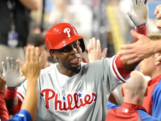 Jun 28, 2013; Los Angeles, CA, USA;  Philadelphia Phillies right fielder John Mayberry Jr. (15) is met in the dugout after a home run in the sixth inning of the game against the Los Angeles Dodgers at Dodger Stadium. Mandatory Credit: Jayne Kamin-Oncea-USA TODAY Sports