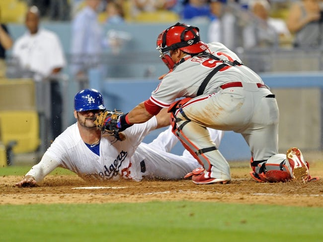 Jun 28, 2013; Los Angeles, CA, USA;  Philadelphia Phillies catcher Carlos Ruiz (51) tags out Los Angeles Dodgers right fielder Scott Van Slyke (33) at the plate in the sixth inning of the game at Dodger Stadium. Mandatory Credit: Jayne Kamin-Oncea-USA TODAY Sports