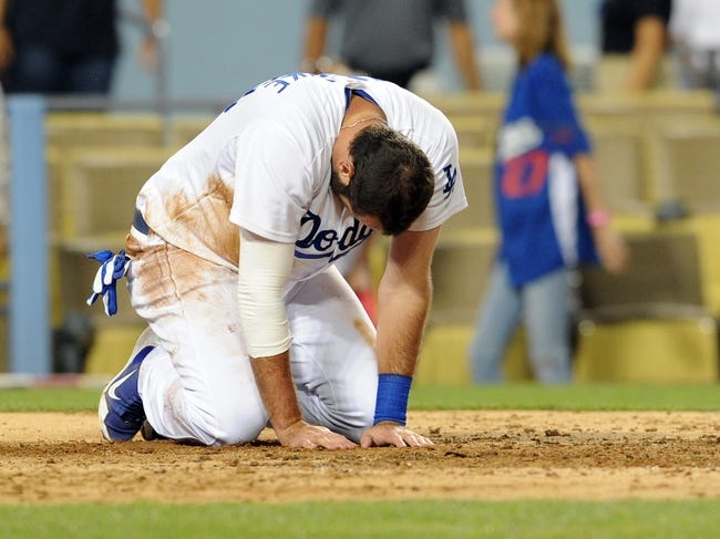 Jun 28, 2013; Los Angeles, CA, USA;  Los Angeles Dodgers right fielder Scott Van Slyke (33) reacts after he was tagged out at the plate in the sixth inning of the game against the Philadelphia Phillies at Dodger Stadium. Mandatory Credit: Jayne Kamin-Oncea-USA TODAY Sports