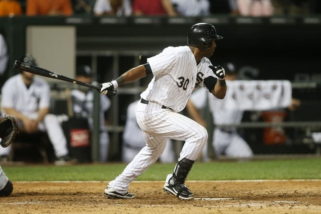 Jun 28, 2013; Chicago, IL, USA; Chicago White Sox center fielder Alejandro De Aza (30) hits a double against the Cleveland Indians during the sixth inning in the second game of a baseball doubleheader at US Cellular Field. Mandatory Credit: Jerry Lai-USA TODAY Sports
