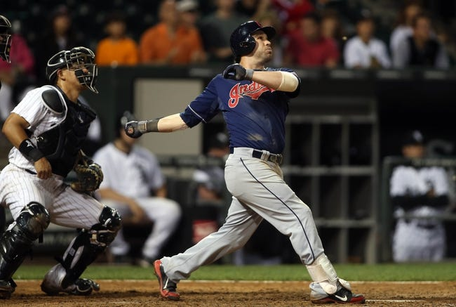Jun 28, 2013; Chicago, IL, USA; Cleveland Indians second baseman Jason Kipnis drives in a run with a sacrifice fly in the 9th inning of the second game of a baseball doubleheader against the Chicago White Sox at US Cellular Field. Mandatory Credit: Jerry Lai-USA TODAY Sports