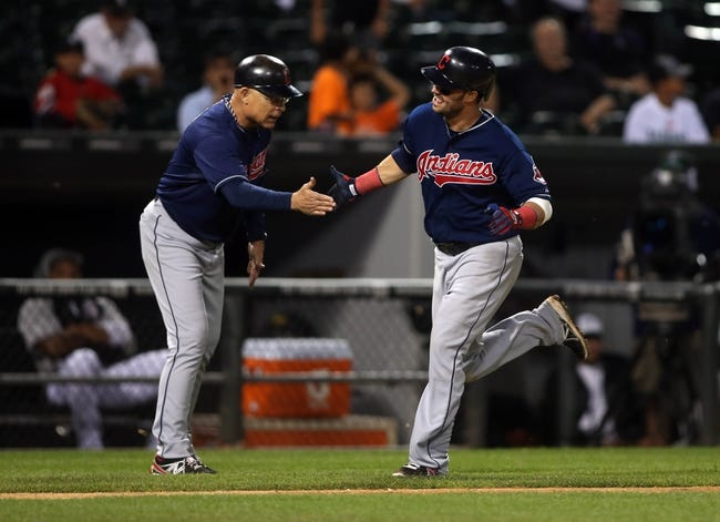 Jun 28, 2013; Chicago, IL, USA; Cleveland Indians first baseman Nick Swisher (right) celebrates with third base coach Brad Mills after hitting a solo home run against the Chicago White Sox in the 9th inning of the second game of a baseball doubleheader at US Cellular Field. Mandatory Credit: Jerry Lai-USA TODAY Sports