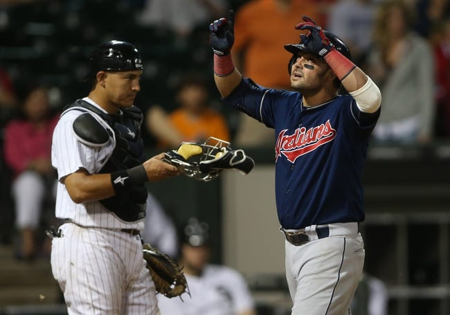 Jun 28, 2013; Chicago, IL, USA; Cleveland Indians first baseman Nick Swisher (right) celebrates after hitting a solo home run as Chicago White Sox catcher Hector Gimenez puts on his mask in the 9th inning of the second game of a baseball doubleheader at US Cellular Field. Mandatory Credit: Jerry Lai-USA TODAY Sports