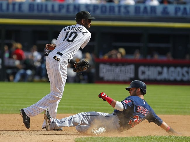 Jun 29, 2013; Chicago, IL, USA; Chicago White Sox shortstop Alexei Ramirez (10) forces out Cleveland Indians first baseman Nick Swisher (33) on the front end of a double play during the fourth inning at US Cellular Field. Mandatory Credit: Dennis Wierzbicki-USA TODAY Sports