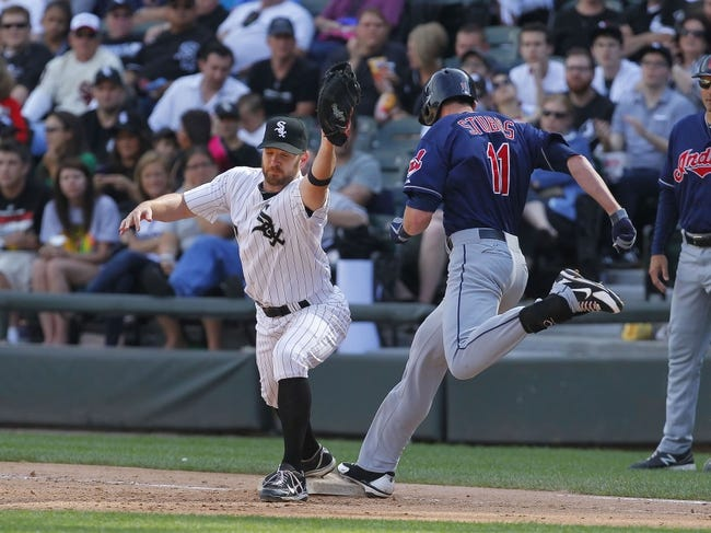 Jun 29, 2013; Chicago, IL, USA; Chicago White Sox first baseman Jeff Keppinger (7) forces out Cleveland Indians right fielder Drew Stubbs (11) during the fifth inning at US Cellular Field. Cleveland won 4-3. Mandatory Credit: Dennis Wierzbicki-USA TODAY Sports
