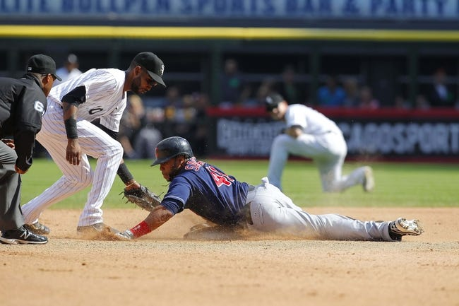 Jun 29, 2013; Chicago, IL, USA; Cleveland Indians catcher Carlos Santana (41) slides safely under the tag of Chicago White Sox shortstop Alexei Ramirez (10) for a double during the fifth inning at US Cellular Field. Cleveland won 4-3. Mandatory Credit: Dennis Wierzbicki-USA TODAY Sports
